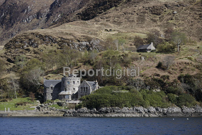 A view from Loch Nevis, of the hills called The Rough Bounds of Knoydart on the Knoydart Peninsula. The house is new and is owned by West End impresario Cameron Mackintosh. - Gerry McCann - 2006-05-04