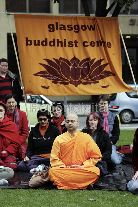 Several hundred people demonstrate in Glasgow against the repression in Burma. Many wore red and chanted and meditated. They lit candles. They were led by Venerable K. Sri Rewatha Thera. - Gerry McCann - 2007-10-06
