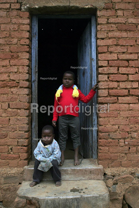 At a community-based scheme in a rural shanty town to support children orphaned by AIDS and related illnesses. Organised by SWAPOL (Swaziland for Positive Living), a group whose lives are seriously affected by HIV/AIDS. - Gerry McCann - 2005-04-25