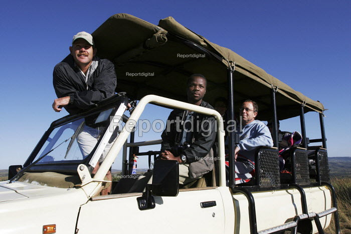 Tourists birdwatching from specially adapted vehicles which escorts travellers through the landscape at iSimangaliso Wetland Park, on South Africas east coast (also called Elephant coast). - Gerry McCann - 2005-05-01