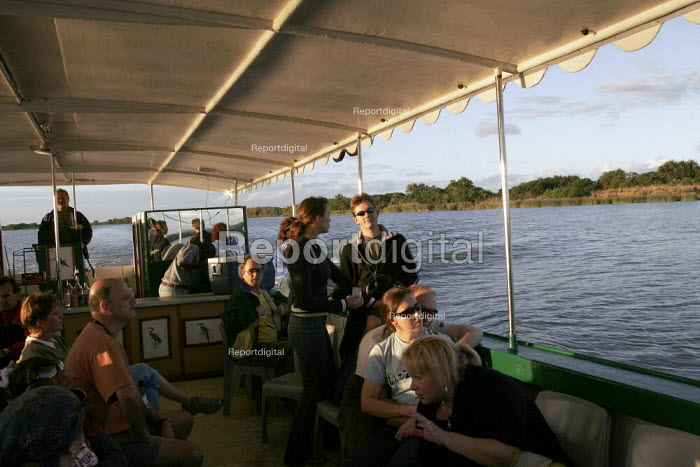 Tourists birdwatching and many types can be seen from the boats which travels the estuary, at iSimangaliso Wetland Park, on South Africas east coast (also called Elephant coast). - Gerry McCann - 2005-04-30