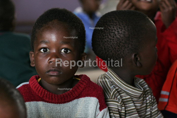 Deaths from AIDS-related illnesses mean that many children are orphaned.  These children live in a church and are looked after by the pastor, some of the children are also HIV-positive. In St.Lucia, South Africa. - Gerry McCann - 2005-05-03