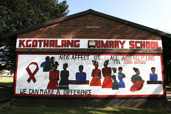 A sign warning about HIV/AIDS and giving a helpline number, on the outside wall of safe school, in a shanty area in Johannesburg. - Gerry McCann - 2005-04-24