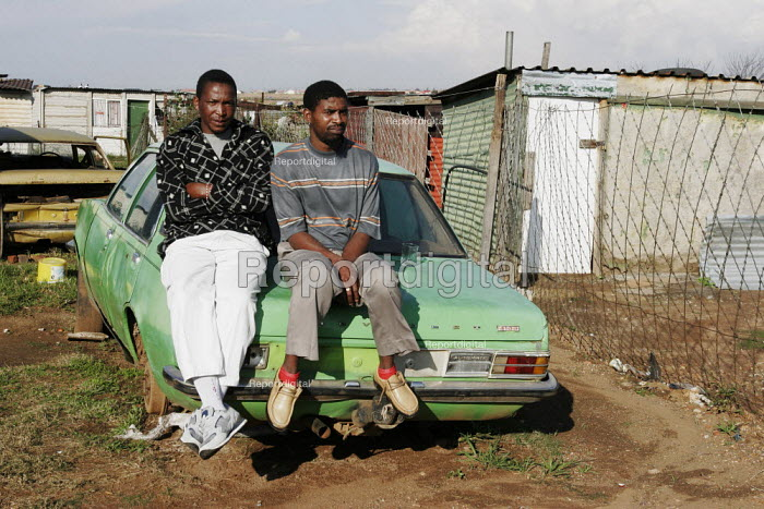 Two young men relaxing with their car, in a shanty area in Johannesburg. - Gerry McCann - 2005-04-24