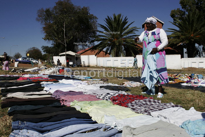 Johannesburg, South Africa, woman selling clothing on the roadside, Sunday morning - Gerry McCann - 2005-05-08