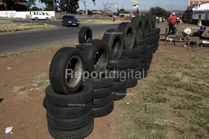 A man selling car tyres on the roadside. - Gerry McCann - 2005-05-08
