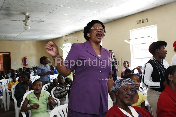 Worshippers at a Gospel church, singing and dancing during the service. - Gerry McCann - 2005-05-08