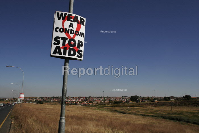 A sign advising using condoms and the dangers of HIV/AIDS, in Johanesburg. - Gerry McCann - 2005-05-08