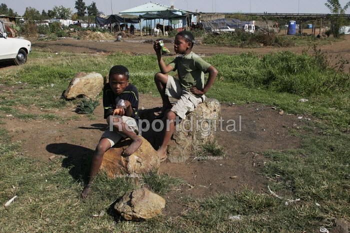 Children relaxing outside, in a shanty area in Johannesburg. - Gerry McCann - 2005-05-08