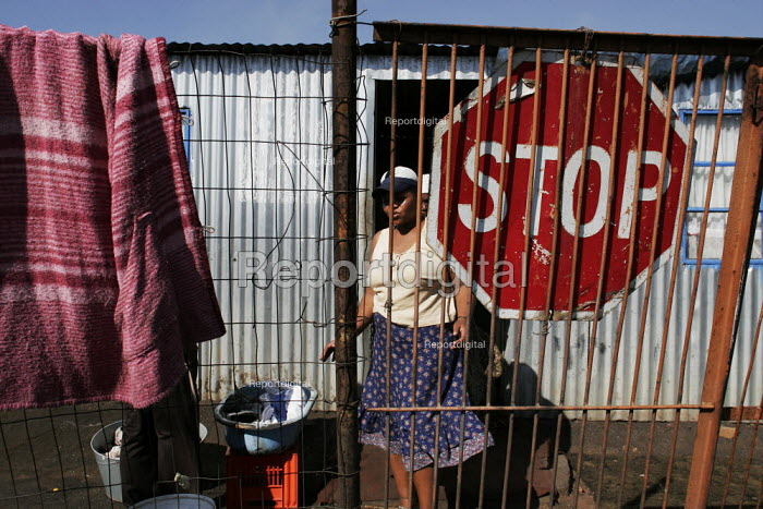 A resident washing up outside, in a shanty area in Johannesburg. - Gerry McCann - 2005-05-08