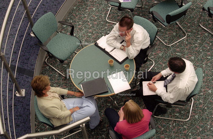 Officer workers and managers in a meeting. - John Harris - 2001-03-29
