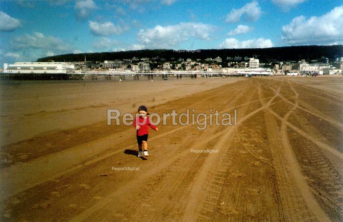 Toddler running down tracks on the beach at Weston Super Mare - John Harris - 2001-09-05