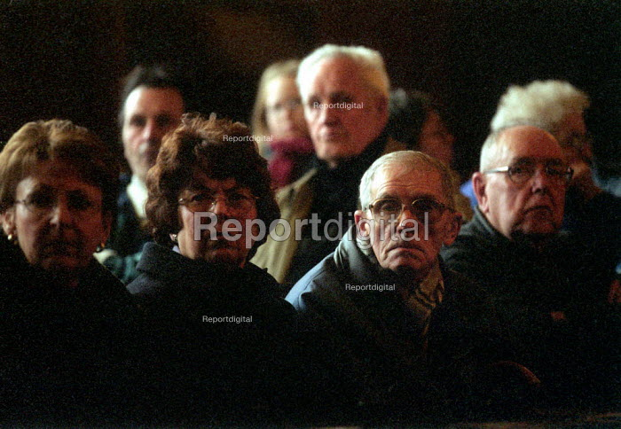 Retired miners, widows and family at an NUM meeting to draw attention to the delay in compensation for occupational diseases contracted whilst mining coal. Typically vibration white finger, and lung diseases. Working men's club, Wigan. - John Harris - 2002-02-21