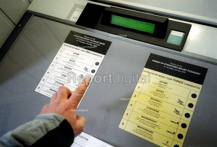 Voter using electronic voting system to vote in elections. - John Harris - 2001-04-02