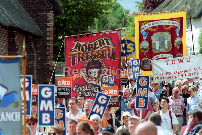 Banner showing Robert Tressell author of the Ragged Trousered Philanthropist, GMB and USDAW banners. Tolpuddle Martyrs Festival Dorset. - John Harris - 2002-07-21