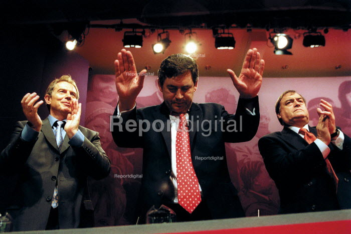 Gordon Brown MP, with Tony Blair and John Prescott acknowledging applause at Labour Party conference 2002 - John Harris - 2002-09-30