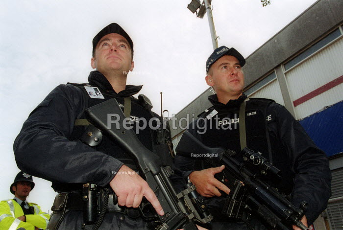 Armed policemen on guard outside Labour Party conference 2002 - John Harris - 2002-09-30