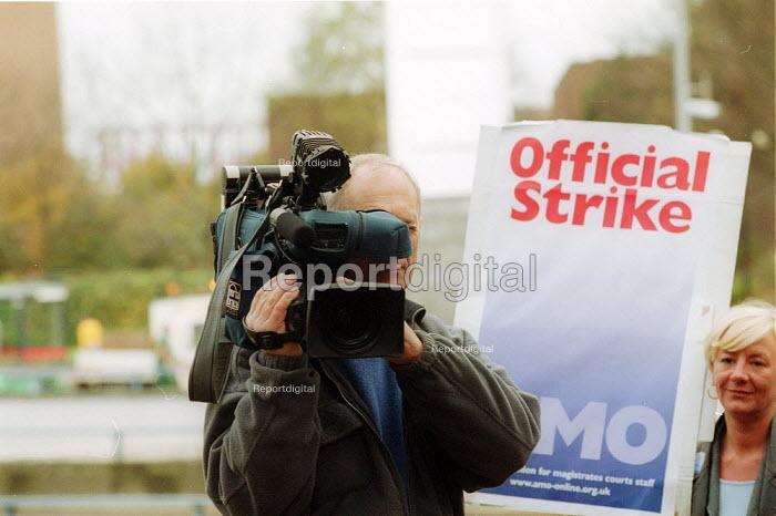 TV cameraman filming picket by striking Magistrates Court Officers - members of AMO, Birmingham. - John Harris - 2002-11-11