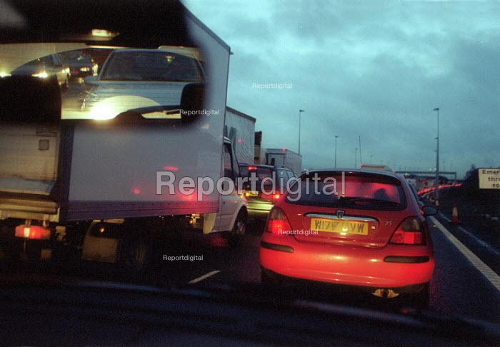 Vehicles in a long traffic jam in roadworks on the M6 motorway - John Harris - 2002-12-11
