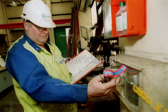 Amicus union organisers making a Health and Safety Inspection, checking safety equipment and protective clothing & goggles. Rhodia Chemicals Oldbury - John Harris - 2002-09-23
