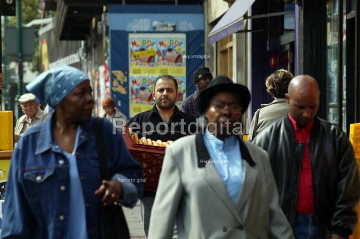 Bread delivery man and people walking down the street, Hackney London - John Harris - 2003-07-31