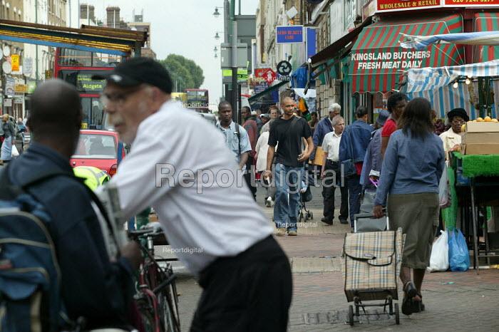 People walking down the street, Hackney London - John Harris - 2003-07-31