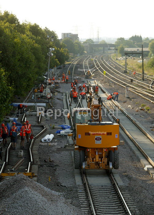 Contractors Jarvis and Network Rail workers renewing worn line on the Great Western Main Line at Slough causing delays to journeys. - John Harris - 2003-08-24