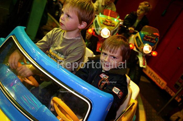 Little boy having fun on a ride at the Stratford Mop Fair. Stratford on Avon Warwickshire. - John Harris - 2003-10-10