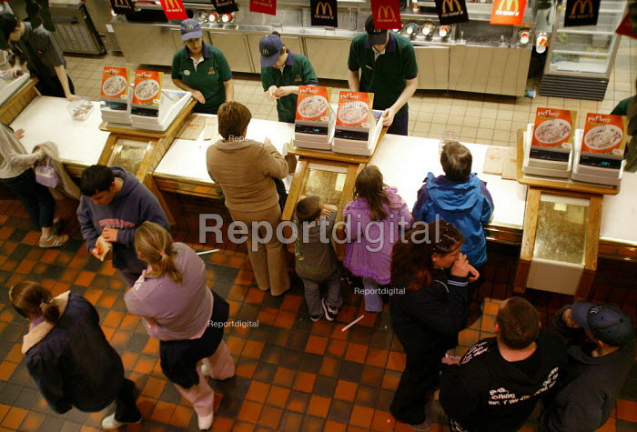Customers buying at McDonalds fast food restaurant. - John Harris - 2003-10-10