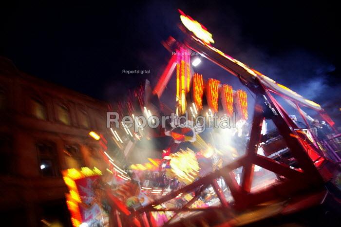Fun on the Chaos ride at the Stratford Mop Fair. Stratford on Avon Warwickshire. - John Harris - 2003-10-10