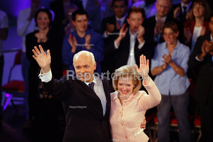 Iain Duncan Smith and Betsy waving at standing ovation, leaders speech Conservative Party Conference 2003 - John Harris - 2003-10-09