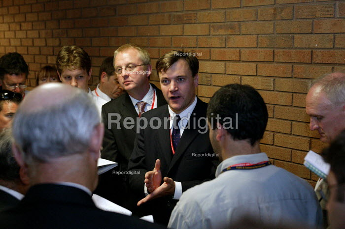 Ed Balls chief economic advisor to the Treasury and Ian Austin (L) Special Advisor talking to journalists after speech by Gordon Brown to Labour Party Conference 2003 - John Harris - 2003-09-29