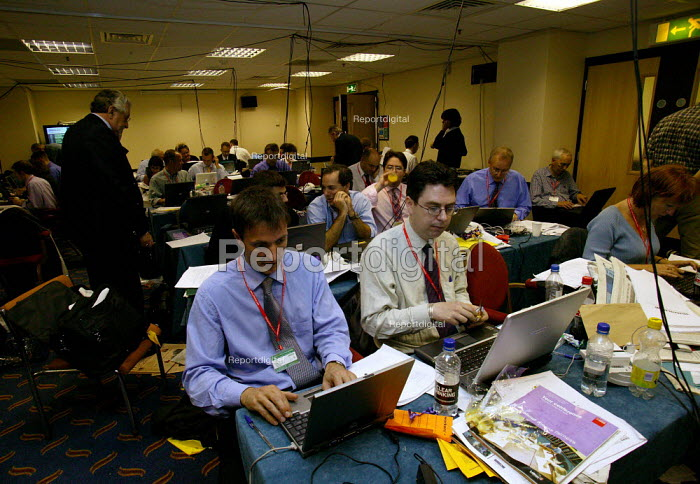 Journalists working in hot and cramped conditions in the press room at Labour Party Conference 2003 - John Harris - 2003-09-30
