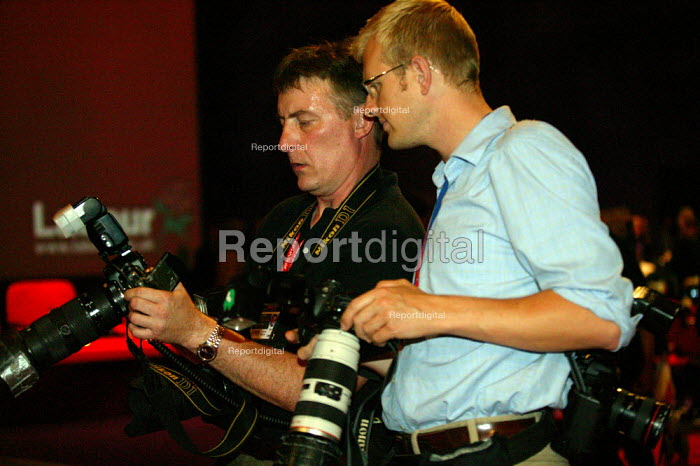 Press photographers checking their digital pictures Labour Party conference 2003 - John Harris - 2003-10-02