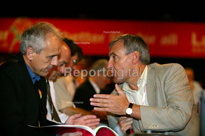 Kevin Curran GMB and Tony Woodley TGWU discussing their vote on Iraq. Labour Party Conference 2004 - John Harris - 2004-09-30