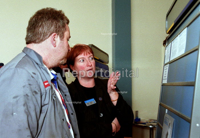 Older worker looking for a job, being advised by Employment Service at an Employment Centre in the works canteen at Rover Longbridge, Birmingham. The scale of the redundancies are unknown. - John Harris - 2000-04-05