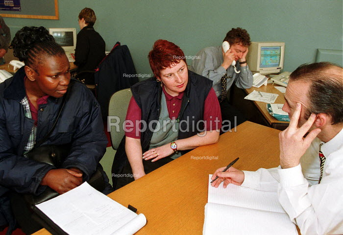 Women workers looking for a job- discussing job vacancies Employment Service at an Employment Centre in the works canteen at Rover Longbridge, Birmingham. The scale of the redundancies are unknown. - John Harris - 2000-04-05