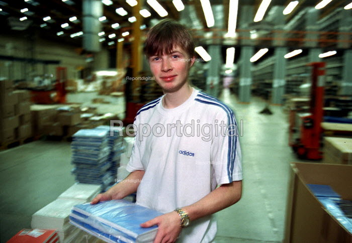 Young worker packing books, production line at OUP automated print distribution centre Corby - John Harris - 1999-12-16