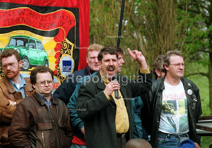 Dr Carl Chinn with Joint Shop Stewards as Rover workers and their families at a demonstration by AEEU, TGWU, MSF, and GMB trades union in support of the Phoenix Towers bid to buy Rover which it is hoped would lead to less redundancies. Longbridge Birmingham. - John Harris - 2000-04-26