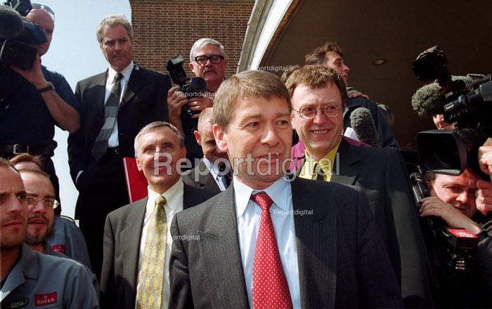 John Towers of Phoenix, L Tony Woodley TGWU, R Richard Burden MP outside Longbridge after deal for Phoenix to buy Rover Longbridge from BMW. - John Harris - 2000-05-09