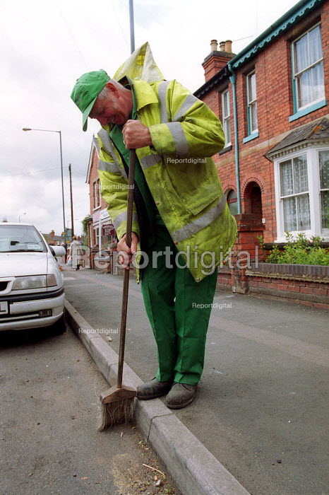 Local authority street cleaner sweeping the gutter. - John Harris - 2000-05-18
