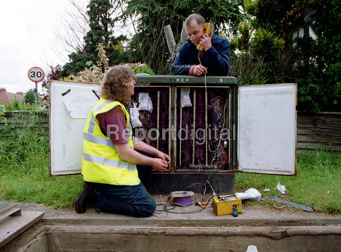 BT engineers replacing a PCP cabinet box, checking telephone line. - John Harris - 2000-06-07