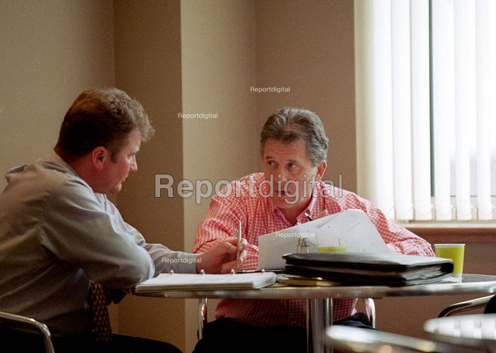 Managers in discussion in canteen. - John Harris - 2000-06-06