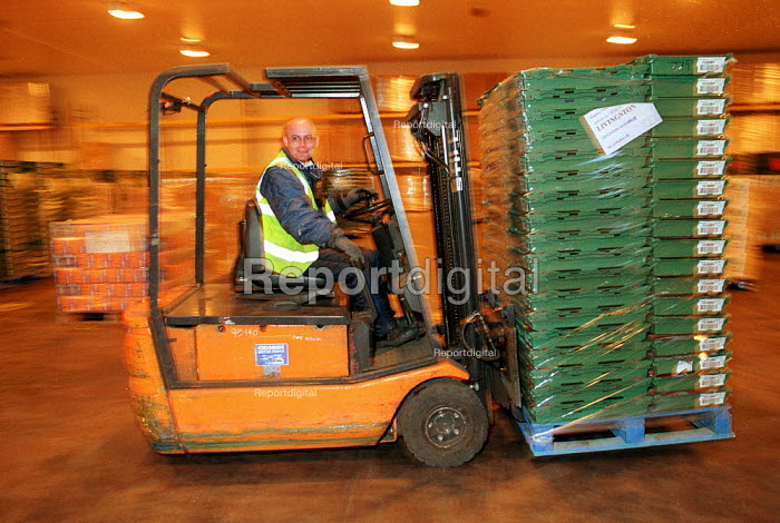 Fork lift truck driver moving pallets to loading bays at a chilled food products distribution centre, Express Chilled Distribution. - John Harris - 2000-08-02
