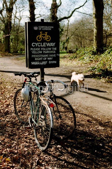 Bicycles padlocked to cycleway Hampsted Heath. - John Harris - 2001-02-27