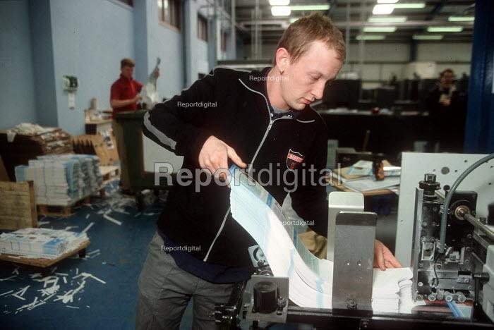 Printer feeding printing machine at printing factory. - John Harris - 2001-04-04