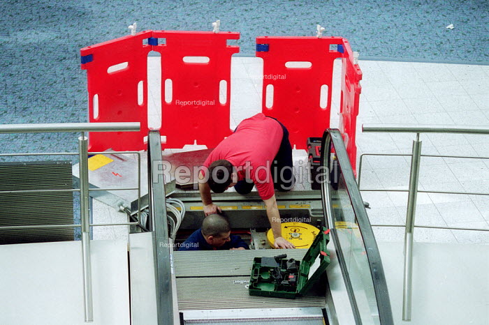 Engineering contractors maintaining an escalator. - John Harris - 2001-04-12