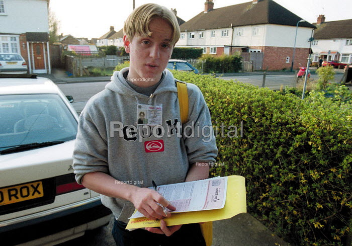 A 2001 Census enumerator filling in a form on a doorstep, Stratford on Avon. - John Harris - 2001-04-27