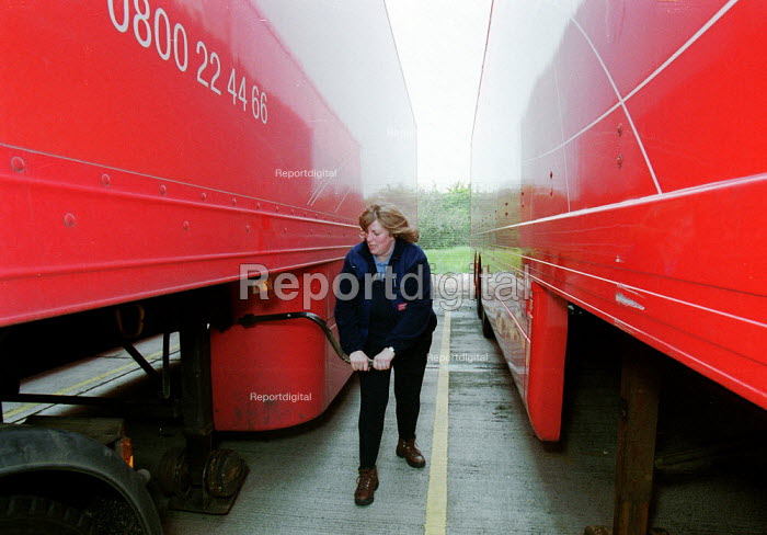 Women truck driver with a 38 ton lorry, having just passed her HGV license driving test. Parcel Force Royal Mail Coventry Hub. - John Harris - 2001-05-10