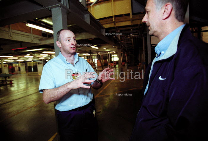 CWU Trades union official talking to member. Post Office Parcel Force Royal Mail Coventry Hub distribution centre. - John Harris - 2001-05-10